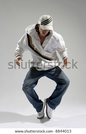 hip-hop style dancer posing on a white background - stock photo