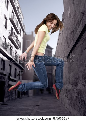 Hip-hop style female dancer in the city - stock photo
