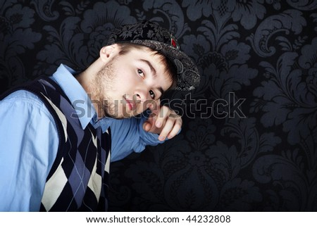 hip-hop style young guy against a black background - stock photo
