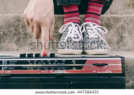 Hip hop woman with a tape recorder enjoying music - stock photo