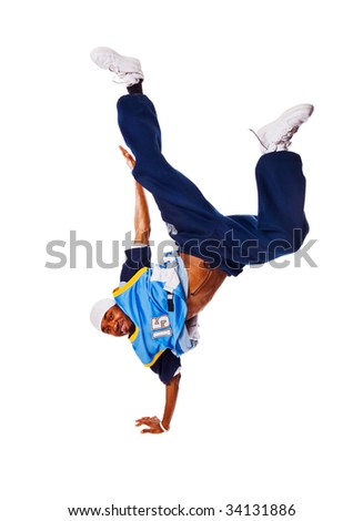 Hip-hop young man making cool move on white background