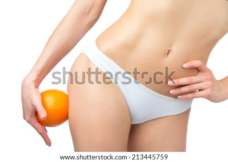 Hip legs abdomen and orange in hand cellulite liposuction woman weight loss control concept isolated against white background - stock photo