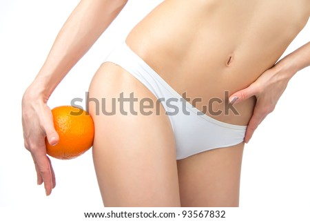 Hip, legs, abdomen and orange in hand cellulite liposuction woman weight loss control concept isolated against white background - stock photo