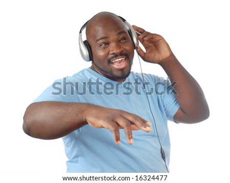 Hip young guy dancing with headphones on - stock photo
