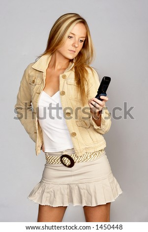 Hip Young Woman with Mobile Phone - stock photo