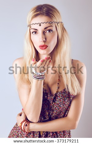 Hippie boho woman sending kiss. Beauty sexy playful positive blonde, long hair, ethnic accessories. Floral sundress, romantic style. Attractive loving girl, portrait.Unusual creative, people,copyspace