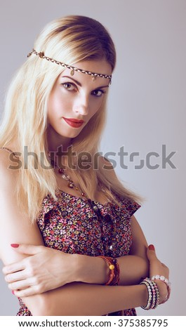 Hippie boho woman sensually looks. Beauty young playful positive blonde, long hair, ethnic accessories relax. Floral sundress, romantic style.Attractive loving girl. Unusual creative, people,copyspace - stock photo