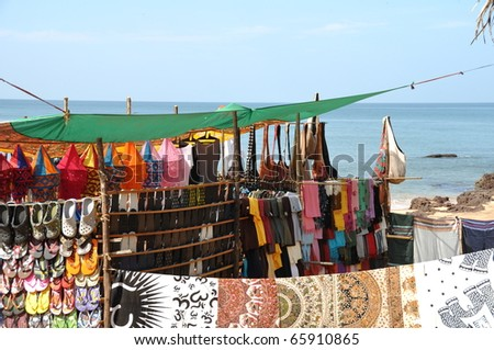 Hippie flee market with fashion cloth at seaside in Anjuna Goa - stock photo
