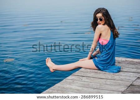 hippie girl on the dock - stock photo