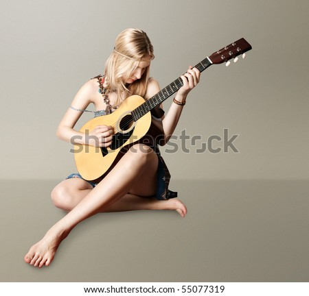 hippie girl with the guitar isolated on white background - stock photo