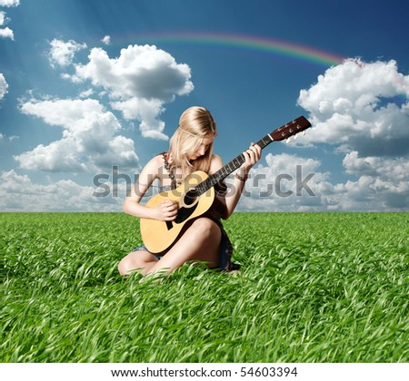 hippie girl with the guitar on open-air rock festival - stock photo