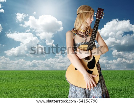 hippie girl with the guitar on openair rock festival - stock photo