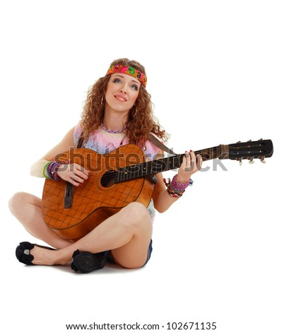 hippie girl with the guitar sitting isolated on white background - stock photo