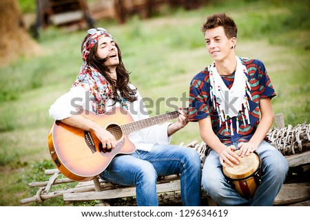 Hippie Group Playing Music and Dancing Outside,Italy - stock photo