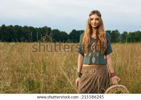 hippie lady in the fields on the grass - stock photo