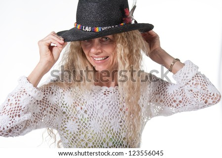 hippie mature woman with Las Vegas hat - stock photo