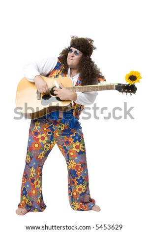 Hippie playing his guitar - stock photo