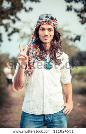 Hippie Portrait showing Peace Sign - stock photo