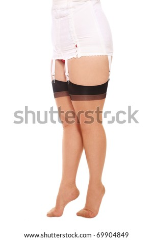 Hips and legs of plus-size woman in vintage lingerie and stockings, on white background