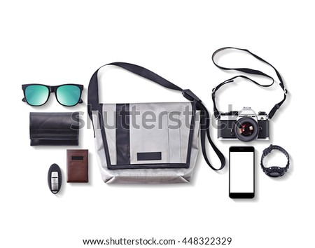 hipster bag and accessories, wallet, vintage camera, smart phone, sunglasses, Watch, car key, business card Cases isolated on white background - stock photo