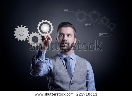 Hipster businessman working on virtual interface with cogwheels - stock photo