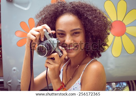Hipster by camper van at festival on a summers day - stock photo