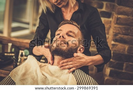 Hipster client visiting  barber shop - stock photo
