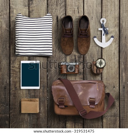hipster clothes and accessories on a wooden background - stock photo