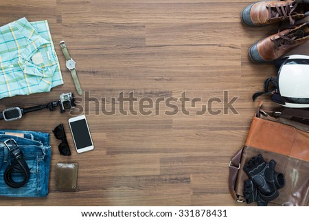 hipster clothes and accessories on a wooden background, View from above with copy workspace - stock photo