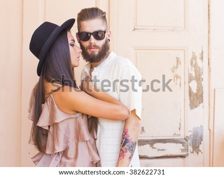 Hipster couple  having an intimate moment very close to one another.