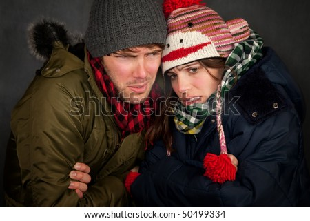 Hipster couple in clothing for cold weather - stock photo
