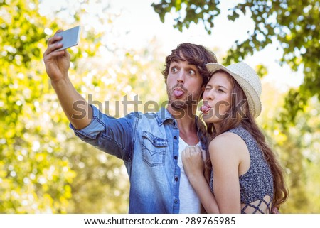 Hipster couple taking a selfie on a summers day - stock photo