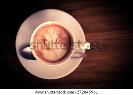 Hipster Cup of coffee  black and  brown vintage on textres wood table hot coffee with leaf art , espresso art Hipster bird's-eye view look 3D  beauty decorate design front of view. - stock photo