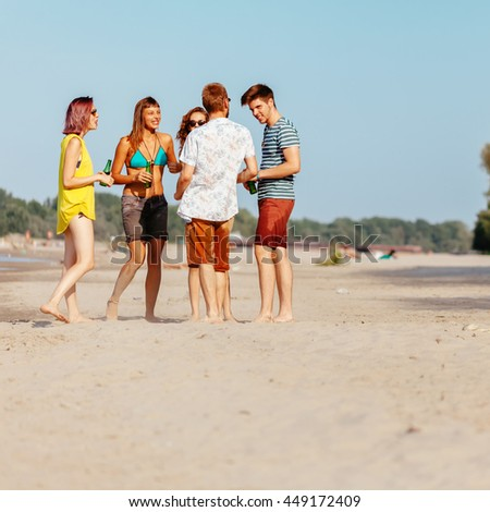 Hipster Friends At The Beach Socializing And Drinking Beer
