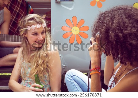 Hipster friends by camper van at festival on a summers day - stock photo