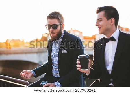 Hipster friends drinking coffee - stock photo