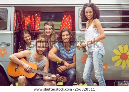 Hipster friends in a camper van on a summers day - stock photo