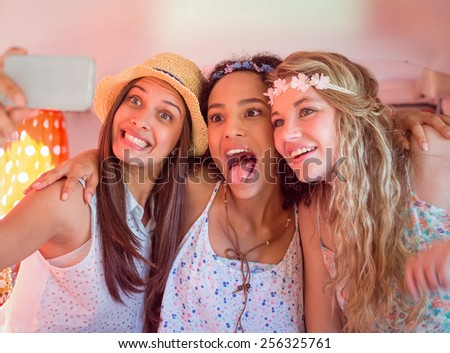 Hipster friends on road trip taking selfie on a summers day - stock photo