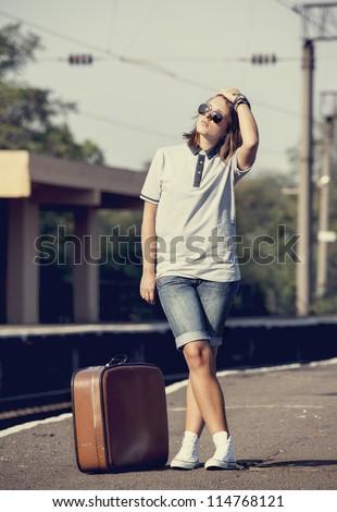 Hipster girl at railways platform. - stock photo