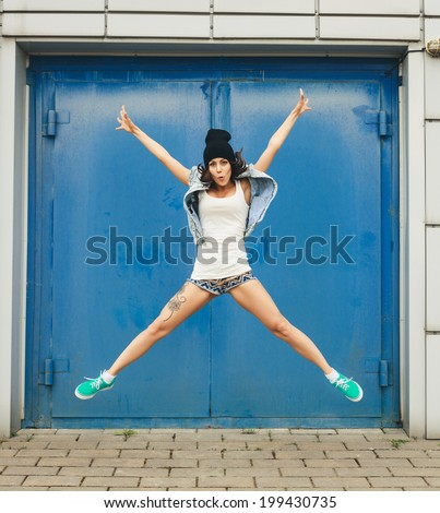 Hipster girl having fun. Lifestyle portrait - stock photo