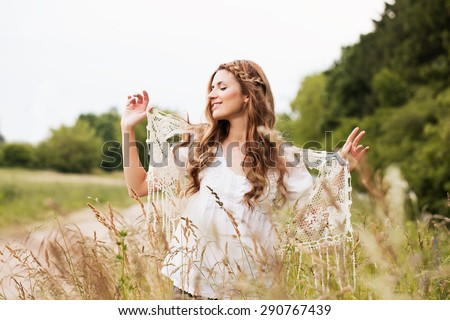 Hipster girl in the summer field