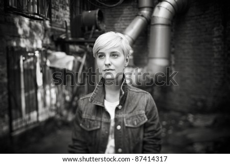 hipster girl (selective focus on face, made with tilt-shift lens) - stock photo