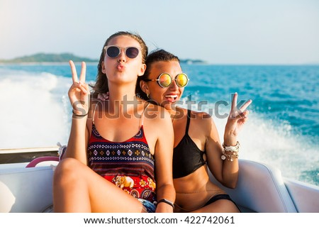 Hipster girl, speed boat, Glamorous tanned Model in fashionable Swimsuit and stylish Accessories at the beach, American flag. California beach, west coast. sexy tanned slim body, wet skin - stock photo
