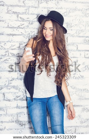 Hipster girl using a phone - stock photo