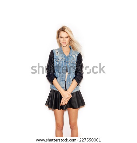 Hipster girl with long blonde hair. Casual style. Looking at camera. Inside.  White background, not isolated - stock photo