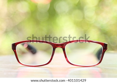 hipster glasses on wooden table with nature background