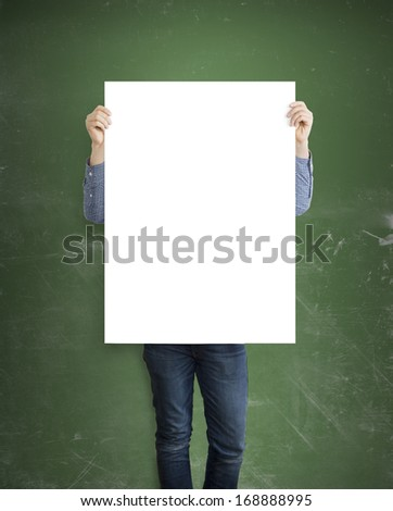 hipster holding placard on green wall