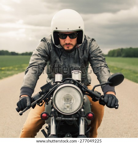 hipster man driving vintage style caferacer stock photo 277049198