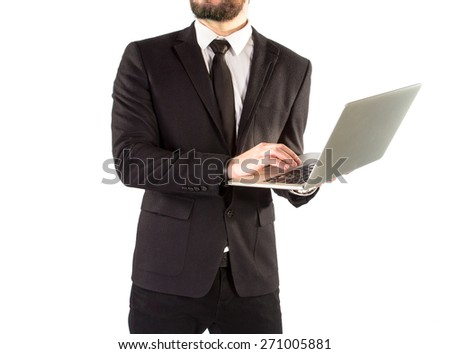 Hipster man in a classic suit isolated on a white background with a notebook in hand. High resolution.  - stock photo