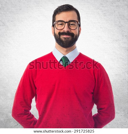 Hipster man over grey background